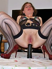 Classy-looking older slut is playing herself