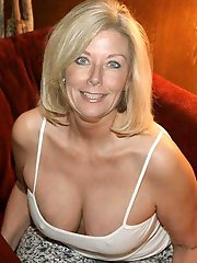 Fantastical experienced dame taking off her bra