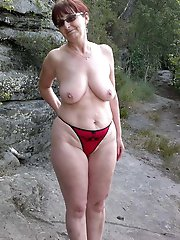 Superb mature female playing with her tits