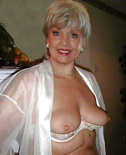Sexy milfs with huge boobies are posing naked