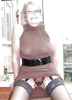 Pretty-looking old lady is performing a nice blowjob