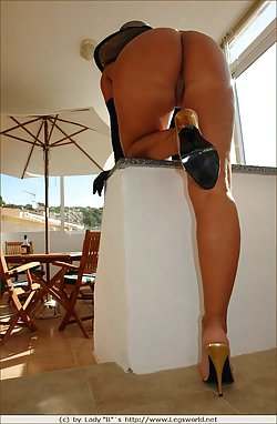 Ideal milf is posing fully naked on the balcony