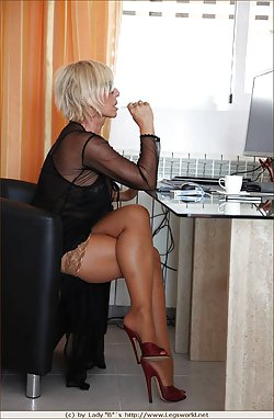 Watch how a sexy mature is working hard in the office