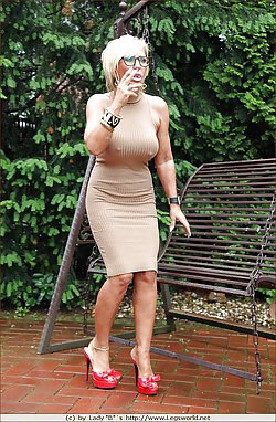 Sweet mom wearing sexy dress is showing her nipples