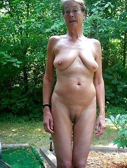 Busty naked older woman is giving a head