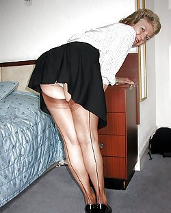 Mature ladies showing their nylon-clad legs
