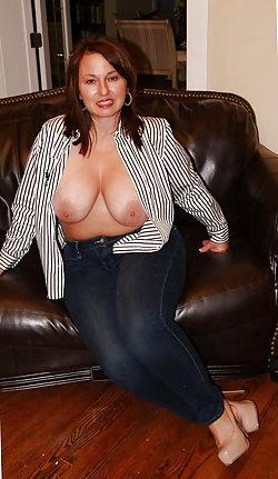 Lovely MILF revealing her holes