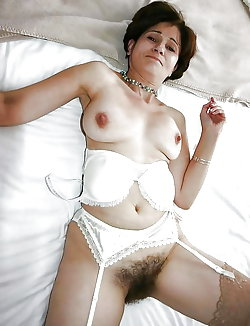 Gorgeous mature lady showing off her breasts